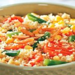 We are talking about Cous Cous or couscous, a traditional Berber dish made from wheat semolina, so to be suitable for a gluten-free diet, it must be precooked corn flour.